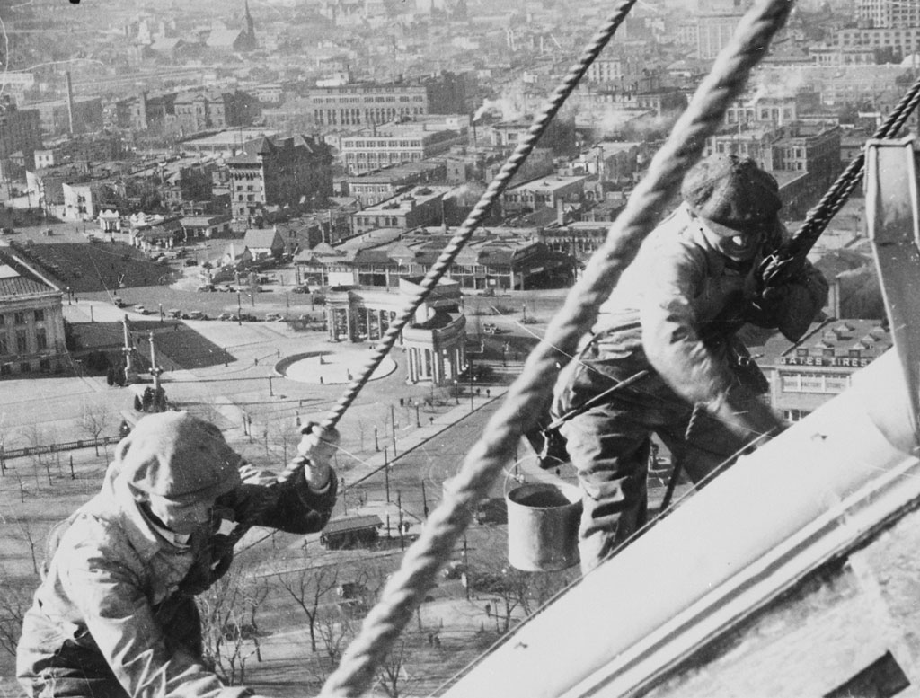 Civil Works Administration (CWA) workmen cleaning and painting the gold dome of the Denver Capitol, 1934. Schafer & Company recently completed the refinishing of the gold dome.